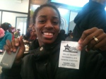 Simone Whitfield, 33, proudly showed off her voting receipt at the Valois breakfast honoring Barack Obama's re-election.